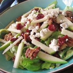 Eat Michigan Salad - lettuce, dried cherries, granny smith apples, goat cheese, and salad dressing sweetened with maple syrup