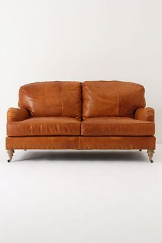 Leather Winifred Settee  at Anthropologie. This couch would be perfect in our living room!