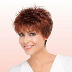 Fun texture and fabulous volume around the crown with tapered sides and the back create this incredible short hairstyle with a cute feathered finish.