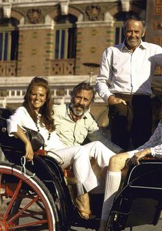 Claudia Cardinale, Jason Robards and Henry Fonda in Italy whilst filming Once Upon a Time in the West.