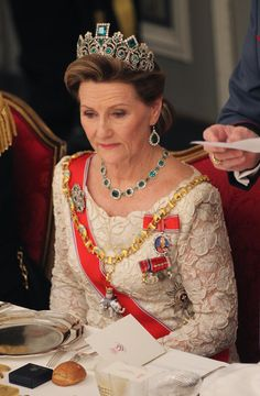 Queen Sonja of Norway wearing the Norwegian Emerald Parure