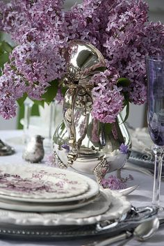 Lavender oakleaf hydrangeas in a silver tea pot with lavender and white china, I want to be invited! By Kimbery McCluskey