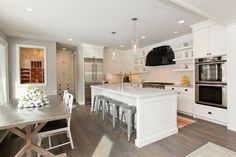 Refined LLC: Gray & orange kitchen design with white kitchen cabinets with marble countertops, chunky ...
