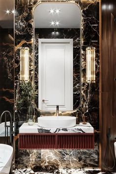 When it comes to bathroom decor, we can present several options such as glamourous, simple, or colorful decor. There are many tricks to convert a typical bathroom into a luxury ambiance, like following the main trends. After all, interior design trends defined brass finishes, marbelized wallpapers, black tubs, and framed mirrors as big hits. Get to know some fabulous bathroom ideas. #bathroomdecor #bathroomideas #interiordesign #homedecor Modern Luxury Bathroom, Bathroom Design Luxury, Modern Bathroom Design, Spa Interior, Shop Interior Design, Interior Design Inspiration, Toilette Design, Luxury Toilet, Palace