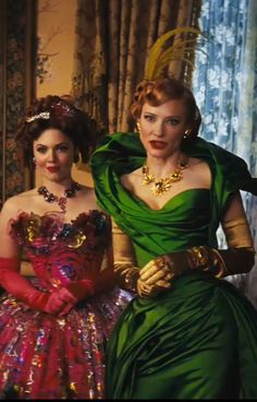Cate Blanchett in 'Cinderella' upcomig there is also a teal and black suit/dress Ill look for it.
