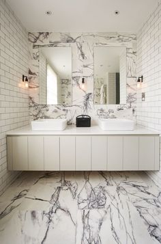 Wow! Our stunning 'Calacatta Viola Marble' - Mandarin Stone. An off white base with a striking deep purple veining. This image shows it being featured in a beautiful bathroom project carried out by Virtruvius and Co. www.mandarinstone.com