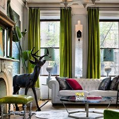 Eclectic Living Room With Long Floor To Ceiling Green Curtains And Glass  Tiled Wall