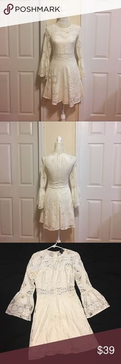 NWOT TOPSHOP Fluted Sleeve Lace Dress in OffWhite. NWOT TOPSHOP Fit and Flare with retro bell sleeves Bohemian Style. Size 4. EU 36. UK 8. 100% Polyester. New, never worn. Topshop Dresses