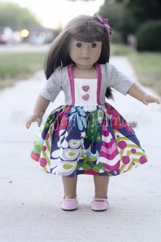 "Pattern for 15"" and 18"" doll dress. Use scraps from your daughter's dress to create a fun, matching dolly dress. These are so quick and fun to make. Velcro closer for the back. 3/4 or long sleeves...."