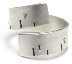 It is a ring that looks like a tape-measure. It will imply that I am a kick-ass seamstress and win me many accolades.