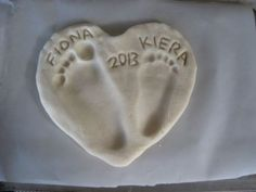 Names and dates carved into the heart with a utensil handle.