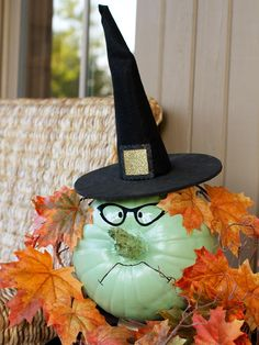 Use a pumpkin and basic supplies from the craft store to make this witchy Halloween decor.