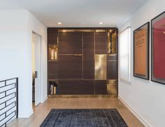 The Amuneal Murphy Bed shown here in silvered walnut and solid brass, this piece can be engineered to fit any space! Use the most of your space without compromising style!