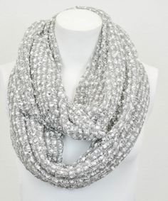 Get the layered look when breezes blow with a single circle of knit goodness. The infinity scarf can be looped once, twice or multiple times for a cozy and chic look.18'' W x 32''circumference100% acrylicHand washImported