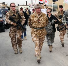 A pair of Royal Military Police (RMP) Close Protection Operatives, carrying C8 CQB carbines, guard British Lt. Gen. John Cooper, the Deputy Commanding General for Multi-National Force-Iraq in As Samawah, Iraq.