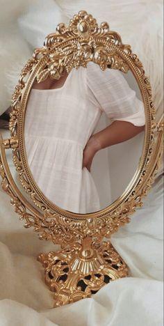 gold mirror selfie