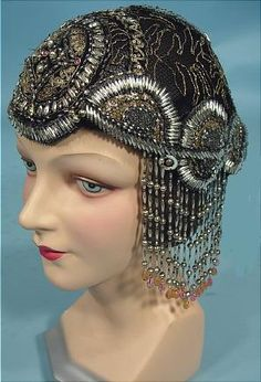 c. 1923/1924 RARE Deco Flapper Beaded Cloche. Full black net cap fully ornamented with gold floss braid, silver and clear beading, and a few great pastel colored beads all in a fabulous deco design. Certainly has that Egyptian feel that was all the rage after King Tut's tomb was discovered in November, 1922