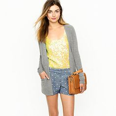 polka dot shorts, yellow tee, grey cardi