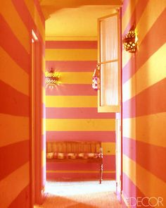 Muriel Brandolini's Vibrant orange-and-pink stripes down the bedroom-corridor walls of his Victorian house in Southampton, New York