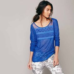 Free People New Romantics Gigi Tee Blue Super soft and light semi-sheer jersey long-sleeve tee in a strong blue with mesh, geometric floral embroidery, and floral lace detailing at the yoke and down the sleeves.Slight hi-lo hem. || 61% rayon, 31% poly Free People Tops Tees - Long Sleeve