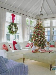 A Beach Christmas is created by adding natural starfish to traditional wreaths and the Christmas tree. Red coral pillows compliment the tradition of Christmas red while maintaining a beach christmas style.