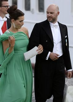 """Emma (née Lendent) and Oscar Magnuson, the son of Princess Christina of Sweden and Tord Magnuson and the nephew of King Carl XVI Gustaf of Sweden, boarding a boat at Riddarholmen to sail to Drottningholm Palace for the wedding banquet; wedding of Princess Madeleine of Sweden and mr. Christopher """"Chris"""" O'Neill in Stockholm, June 8th 2013"""