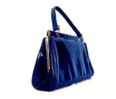 1950s early 60s brilliant blue patent pleather kelly bag. $41.23, via Etsy.