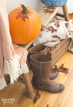 Cozy fall entry decor with pumpkins and leaves