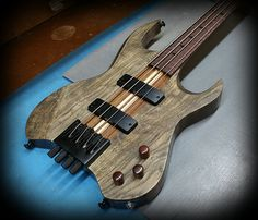 Kiesel Guitars Carvin Guitars  VB4 (Headless Vader Bass Series) Ash body with antique ash treatment in a satin finish