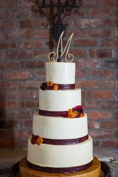 Raspberry fruit leather ribbon, dehydrated peach and plum roses, white chocolate SMBC Wedding Cake