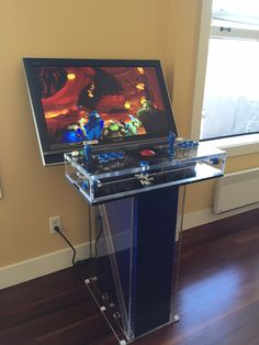 Dylan Joy, another TAP satisfied customer, wanted to thank the Seattle store for helping him build his custom acrylic arcade cabinet. The materials were and clear acrylic and TAP did all the cutting and drilling. Retropie Arcade, Arcade Bartop, Arcade Stick, Arcade Room, Arcade Games, Arcade Table, Video Game Rooms, Video Games, Diy Projects Man Cave