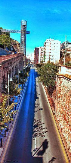 Calle Gisbert con el ascensor panorámico al fondo a la izda. Cartagena*. Murcia-Spain