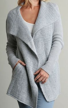 Trust me when I say our Quinn cardigan will get plenty of wear this fall and winter. This open front, double breasted knit cardigan looks great with absolutely everything. It's warm, but not so warm t