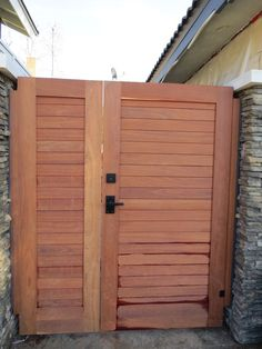 Side yard wooden gate with nero contemporary lever latch and deadbolt to lock a gate