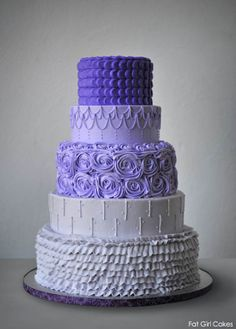 Stunning purple ombre weddding cake. Love that each tier has a unique design!