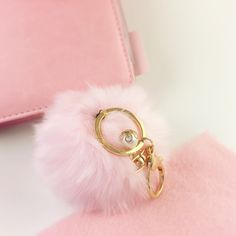 Host PickRabbit Fur Pom Pom NWT! Pink Rabbit fur key/purse Pom Pom. Pink with golden chain, and beautiful white pearl. Great eye catcher. Perfect gift   ▪️NWT ▪️Smoke/Pet free No Trade  Happy Poshing❣ Accessories