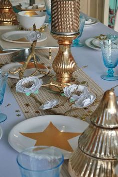 Sparkly table at a turquoise and gold Christmas party! See more party planning ideas at CatchMyParty.com!