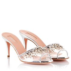 Sebastian mules have been crafted in Italy from metallic leather and transparent vinyl. This chic pair is set on a stiletto heel and has a peep toe. They're embellished with crystal rocks for an eye-catching effect. Wear yours to the office of dinner.