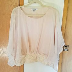 Flowy feminine top Has a floral lace pattern around the bottom with buttons to loosen up for getting on/off. Very flowy and comfy and super pretty just not my style! Never worn. Forever 21 Tops