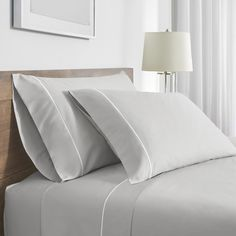With quality and craftsmanship evocative of the world's finest hotels, the FlatIron Hotel Satin Stitch Sheet Set offers the same timeless elegance for your home. Embroidered with rows of distinctive satin embroidery, this set owes its softness to premium cotton with a sateen weave for a lustrous sheen and wrinkle resistance. The FlatIron Hotel Stitch Sheet Set contains a flat sheet, fitted sheet, and two pillow cases. Colors choices include White with White embroidery, White with Indigo…