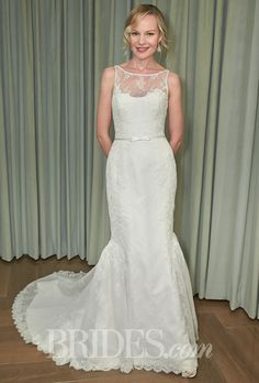"""Brides.com: Amy Kuschel - 2014. Style 1-PRM-1480-A, """"Monroe"""" sheer bateau with sweetheart neckline trumpet wedding dress in American made Primrose lace and French grand peony applique, Amy Kuschel"""