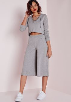 Oh hot damn! We can't wait to get our hands on these epic pants! In a thick jogger jersey these culottes scream comfy! Wear with a plain white tee, sneaks and a grey jumper to get simple style to work all day long.