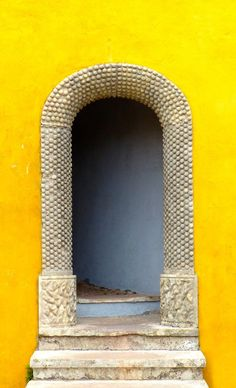 Portugal is a beautiful country with some very cultural places to visit from Fatima, Cascais and of course the capital, Lisbon. This brightly colours archway has culture, art and creativity all in one - found in Sintra, another beautiful down on the hills of Portugal #Portugal #Sintra #archway