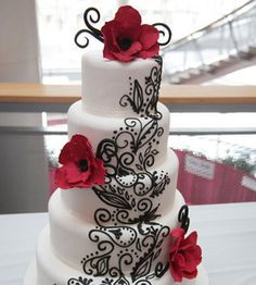 5 tower wedding cake with intricate flower designs.