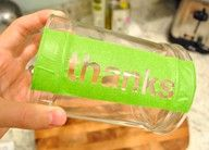 Glass etching! Print out any saying you want on a piece of paper and trace the outlines of the letters onto contact paper (on the non-sticky side; sharpie is best).  Stick the contact paper onto the glass object.  Cut out the letters with a small utility knife and remove what you cut out.  Gently paint glass etching cream over the cut-out letters with a foam brush.  Leave on for at least 5 minutes.  Remove cream with water and remove rest of contact paper.  Done!