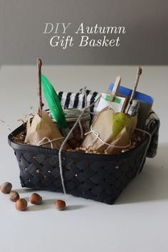 DIY Autumn Gift Basket... mason jar filled with flavored nuts, kitchen towels,  a notebook, and gift card with a mini-clothes pin...