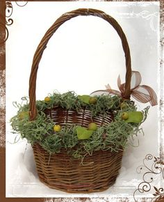 A sweet little natural twig basket decorated with moss, faux leaves and berries