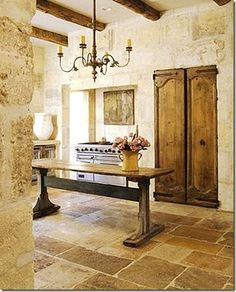 A stone wall-stone fllors and niche for the stove-Chateau Domingo. I love the combination of light stone with dark, rustic elements. Chalky gray, perhaps...
