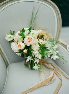 coastal-inspired bouquet featuring garden roses and clemantis by Jackie's Flowers