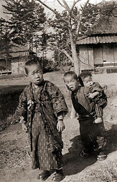 Japan early 20 C. Rural kids, one carrying a baby.